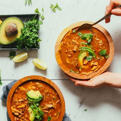 Grabbing a spoonful of Vegan Tortilla Soup topped with cilantro and avocado