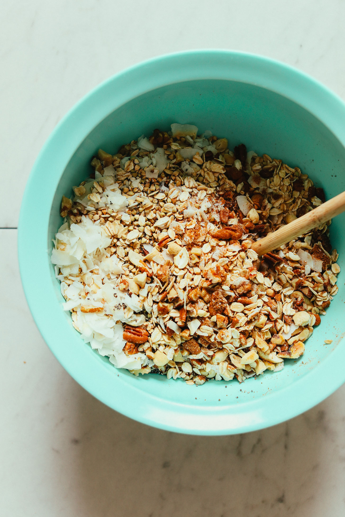 Stirring together dry ingredients for our Easy Buckwheat Granola recipe