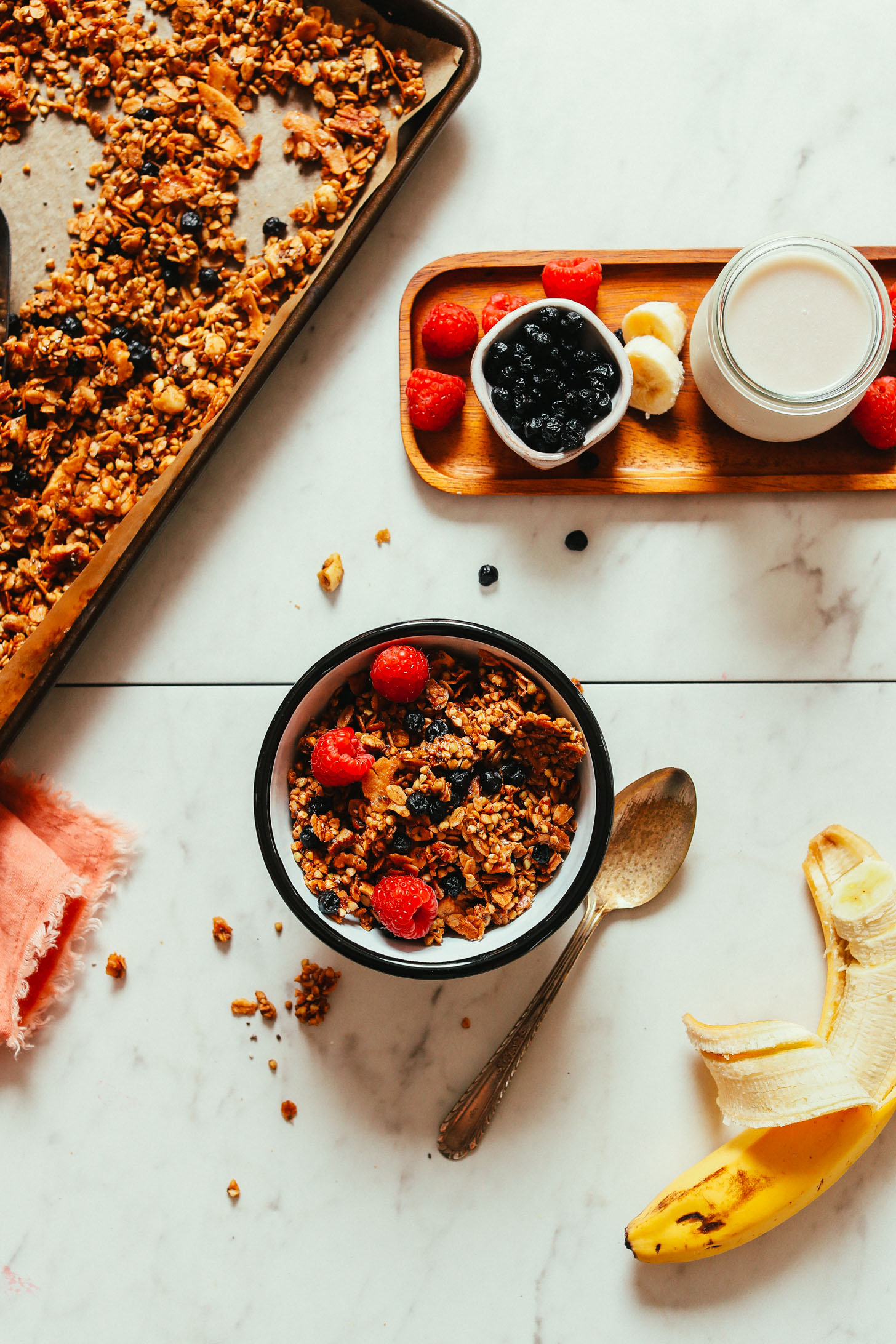 Bowl of Buckwheat Granola with berries, banana, and almond milk in the photo