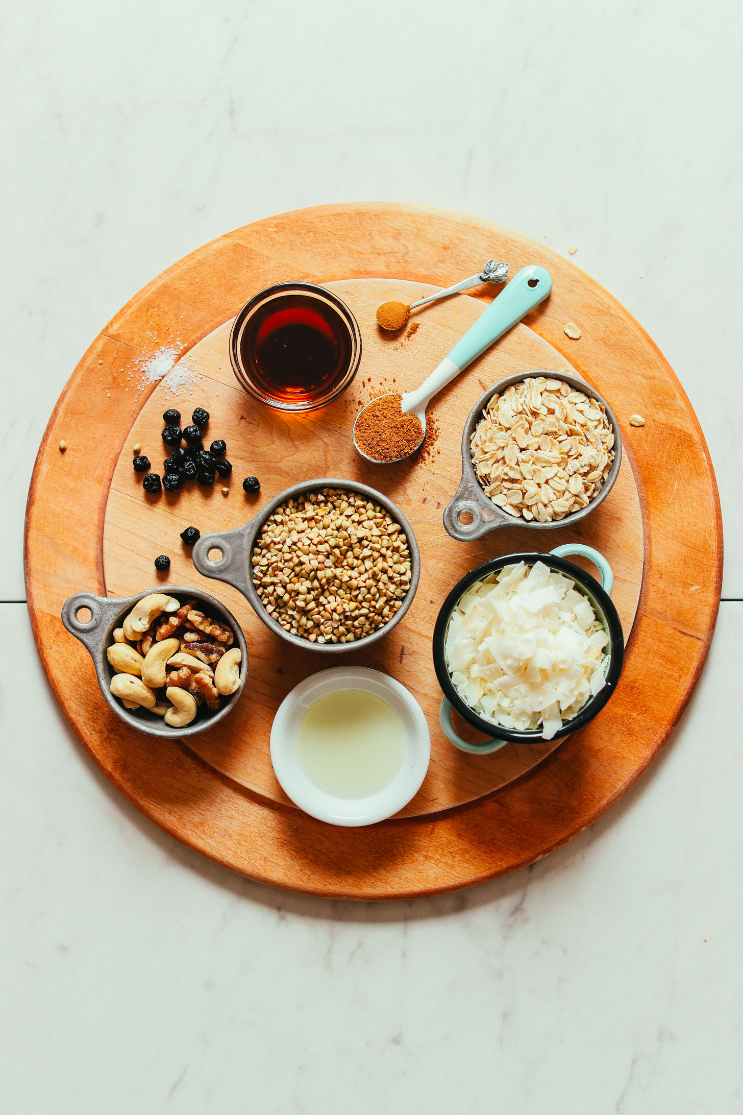 Wood board with ingredients for making gluten-free vegan Easy Buckwheat Granola
