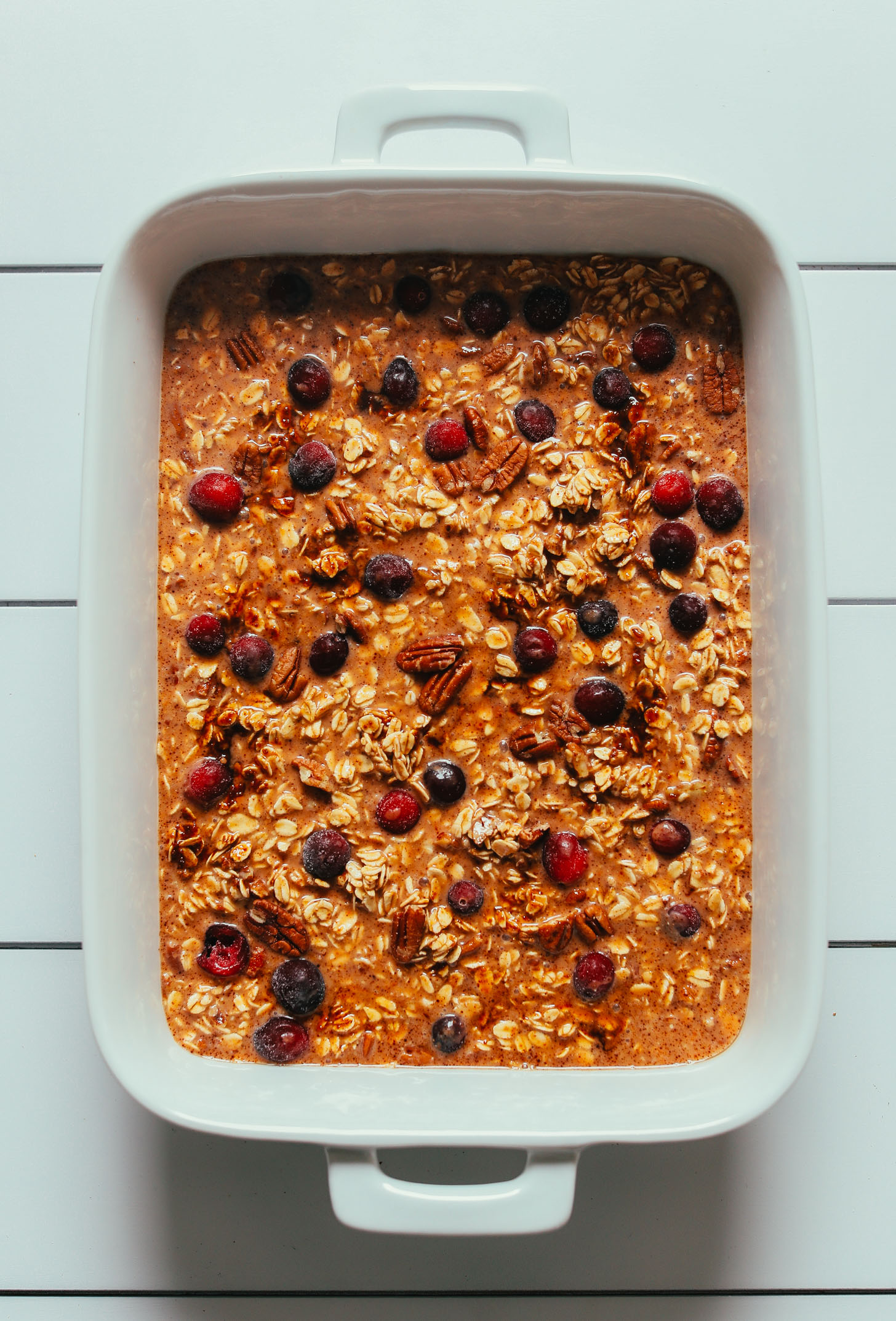 Baking dish of our Vegan Pumpkin Baked Oatmeal with Cranberries recipe