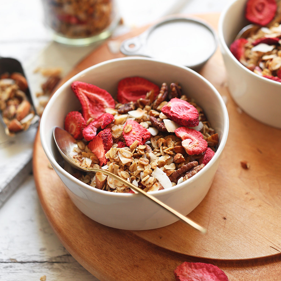 Spoon resting in a bowl of Coconut Strawberry Granola