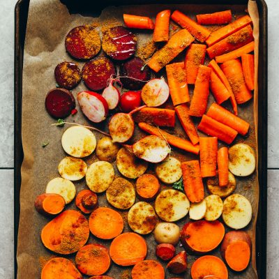 Tray of sliced carrots, beets, radishes, and sweet potatoes for roasting
