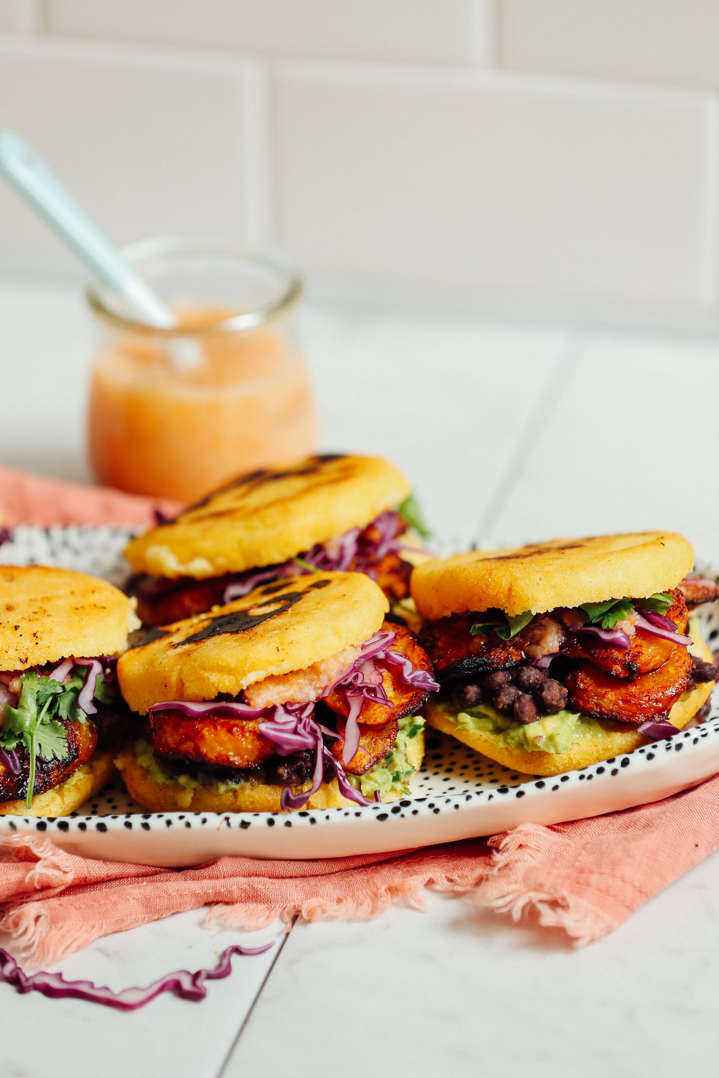 Platter filled with gluten-free Vegan Arepa Sandwiches