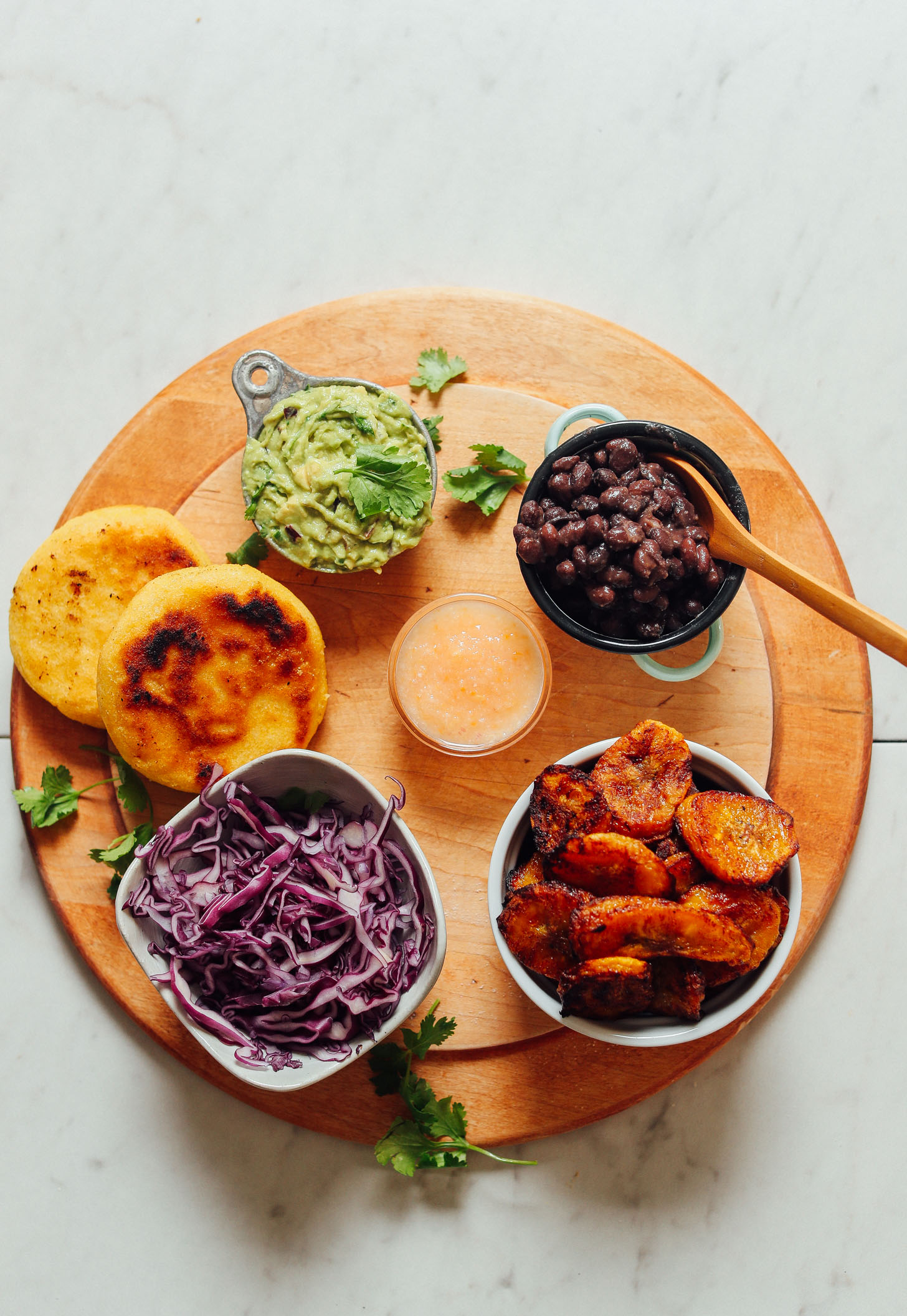 Tray of ingredients for making gluten-free Vegan Arepa Sandwiches