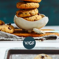 Baking sheet and bowl of Grain-Free Vegan Trail Mix Cookies