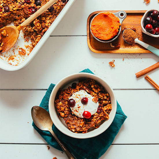 Bowl and pan of our incredible Pumpkin Baked Oatmeal perfect for fall