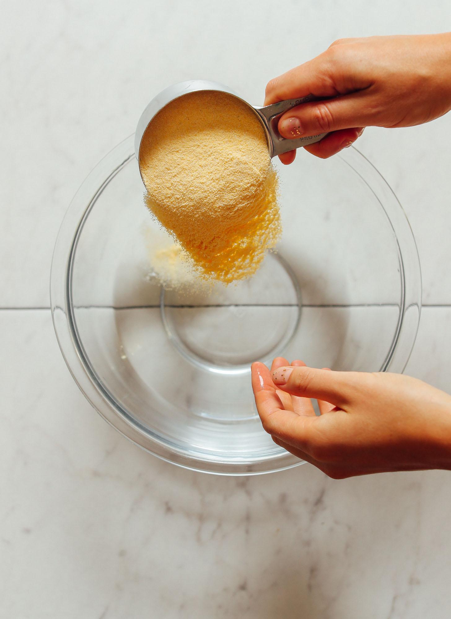 Pouring areparina into a bowl for homemade Arepas