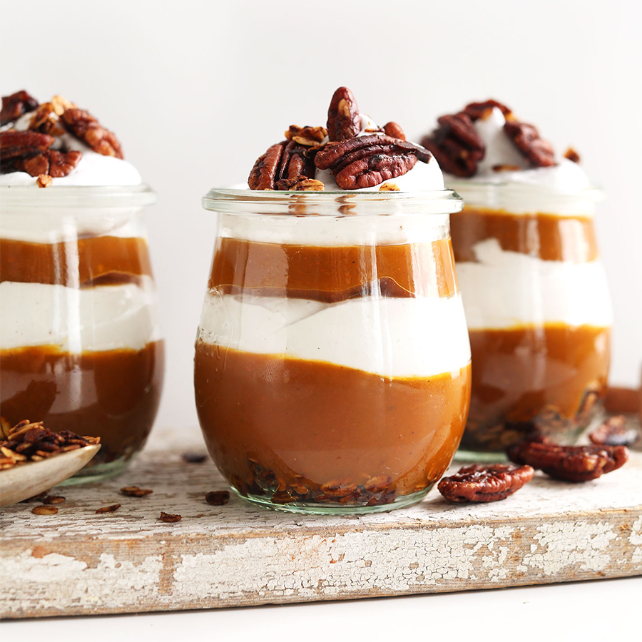 Three jars of Pumpkin Pie Parfaits topped with pecans
