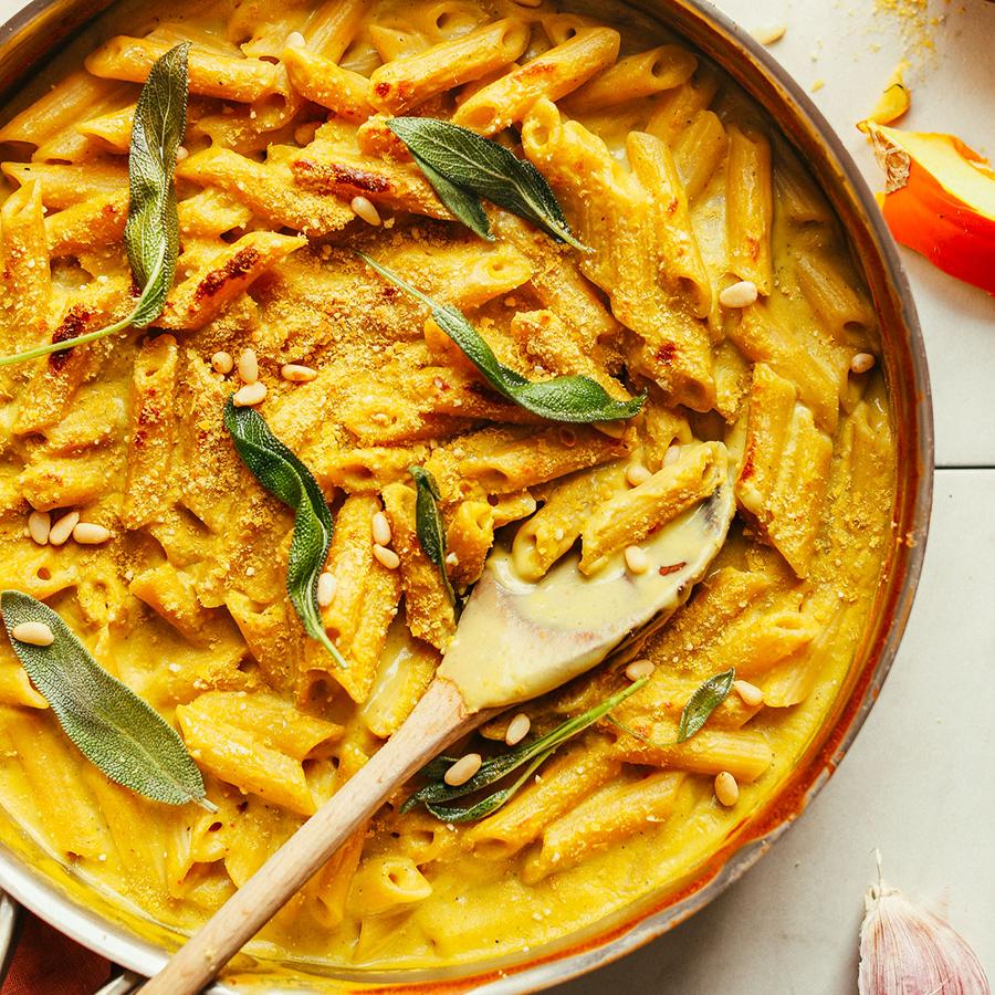 Pan of Gluten-Free Vegan Pumpkin Pasta topped with sage leaves