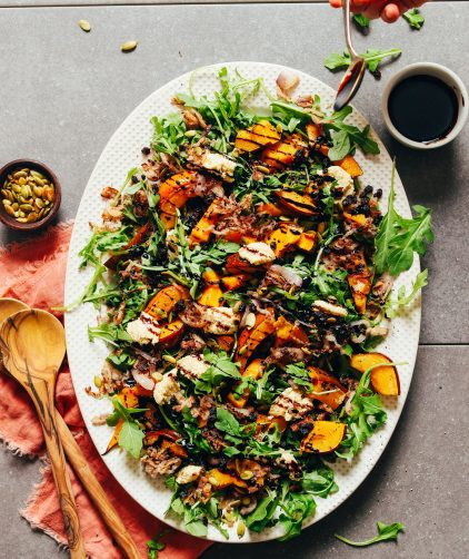 Large platter filled with delicious plant-based Roasted Squash Salad with Nut Cheese and Balsamic
