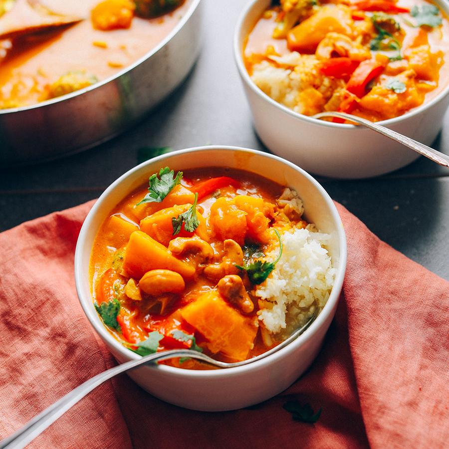 Bowls of Vegan Yellow Pumpkin Cashew Curry