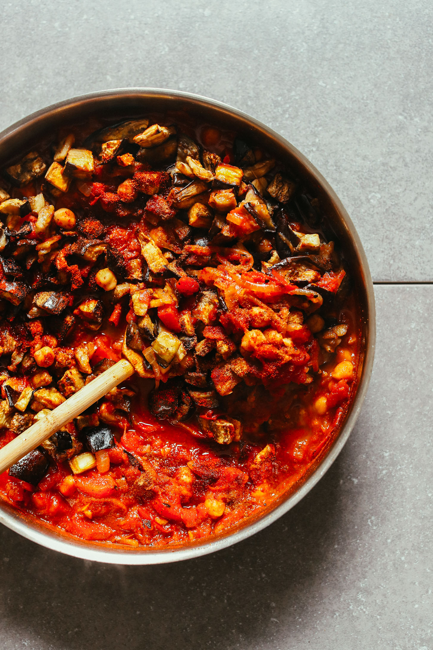 Cooking Moroccan-Spiced Roasted Eggplant & Tomato Stew in a large skillet