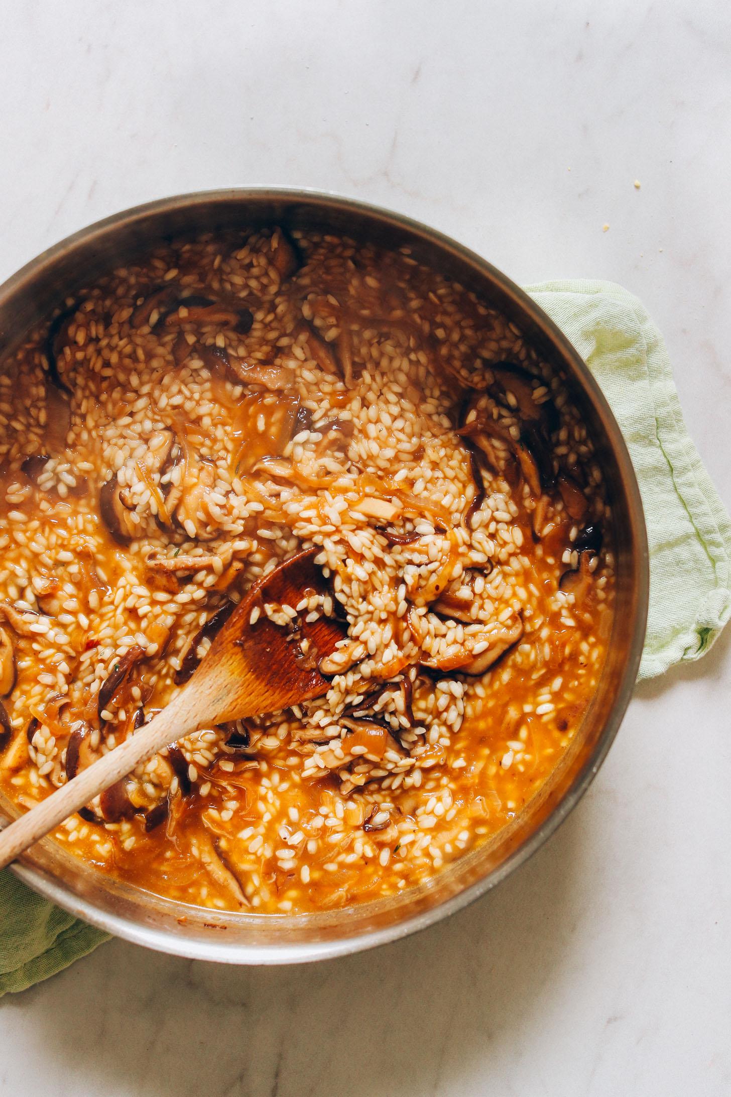 Stirring a batch of our Vegan Caramelized Shiitake Mushroom Risotto recipe
