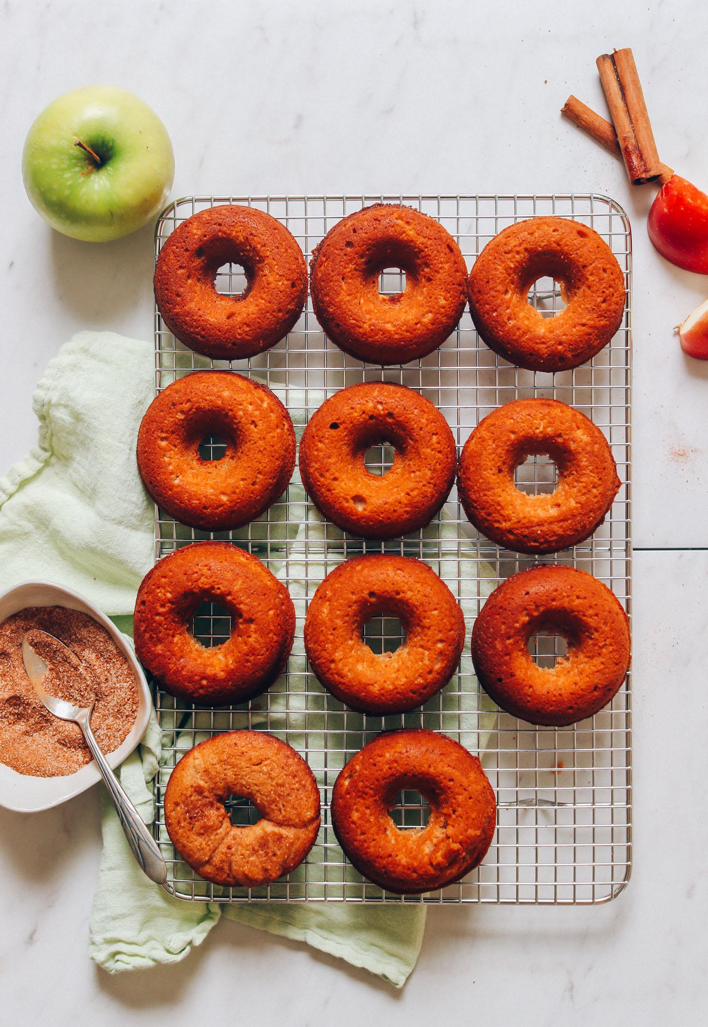 Freshly baked Vegan Gluten-Free Apple Cider Donuts resting on a cooling rack