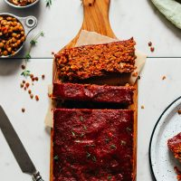 Partially sliced loaf of delicious Vegan Lentil Meatloaf