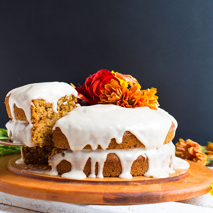 Using a cake server to remove a slice of Easy Homemade Pumpkin Cake from a cutting board