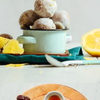 Bowl of our Lemon Poppy Seed Donut Holes and cutting board with ingredients to make them