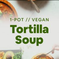 Bowls of Vegan Jackfruit Tortilla Soup topped with avocado and cilantro