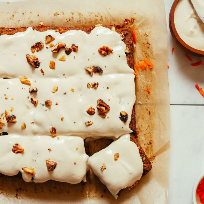 Carrot Apple Snack Cake resting on a piece of parchment paper