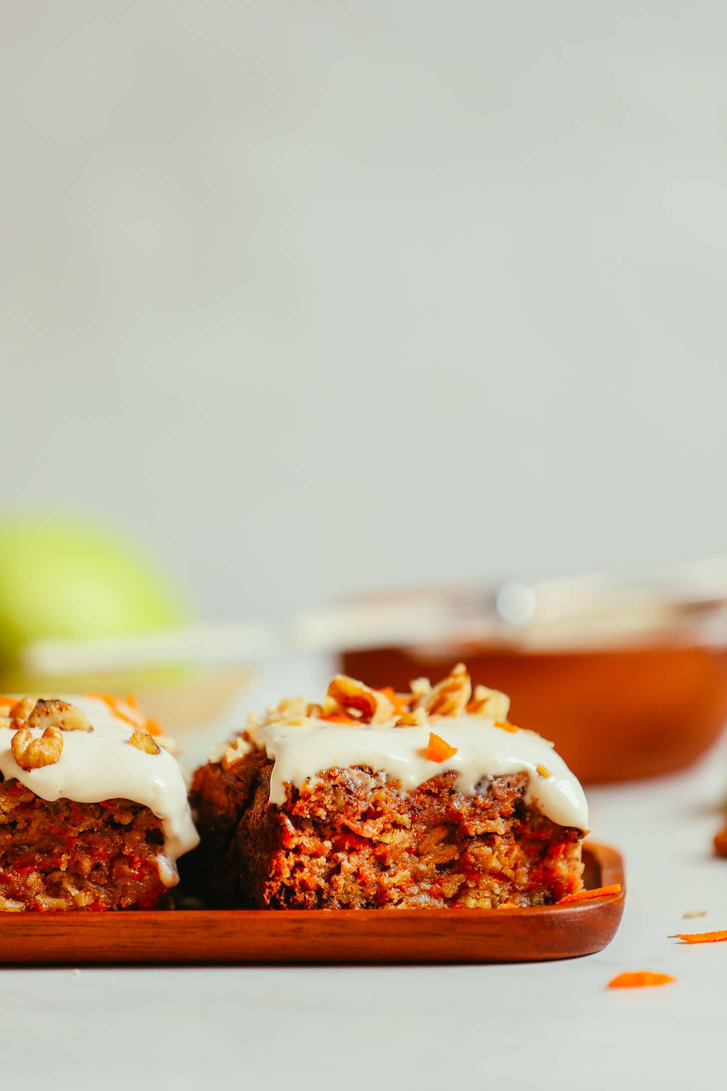 Slices of Carrot Apple Snack Cake resting on a wood platter