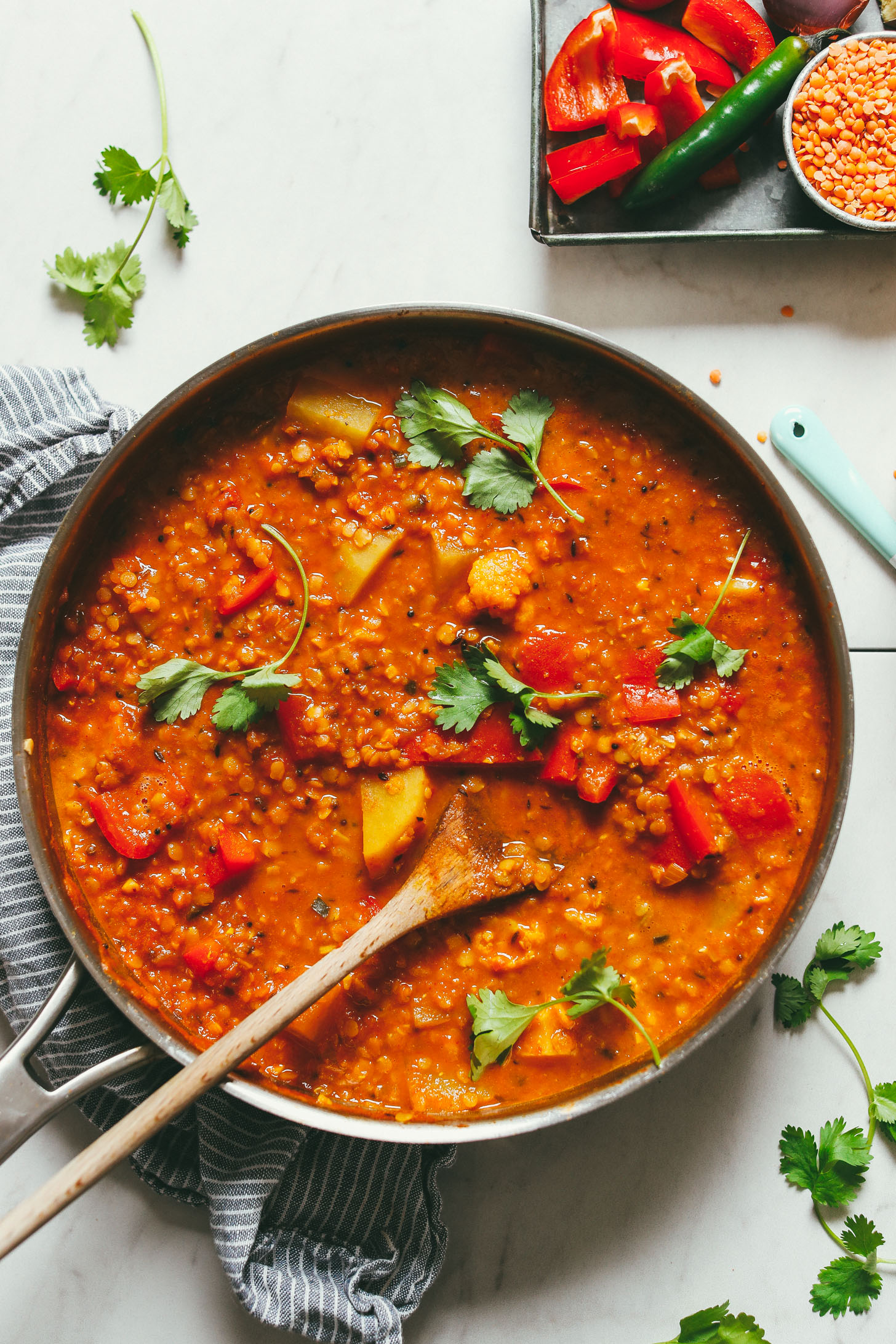 Large pan filled with gluten-free vegan Cauliflower Potato Red Lentil Curry