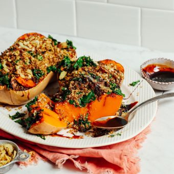 Tray of Stuffed Butternut Squash with Quinoa, Mushrooms, Kale and Balsamic Glaze