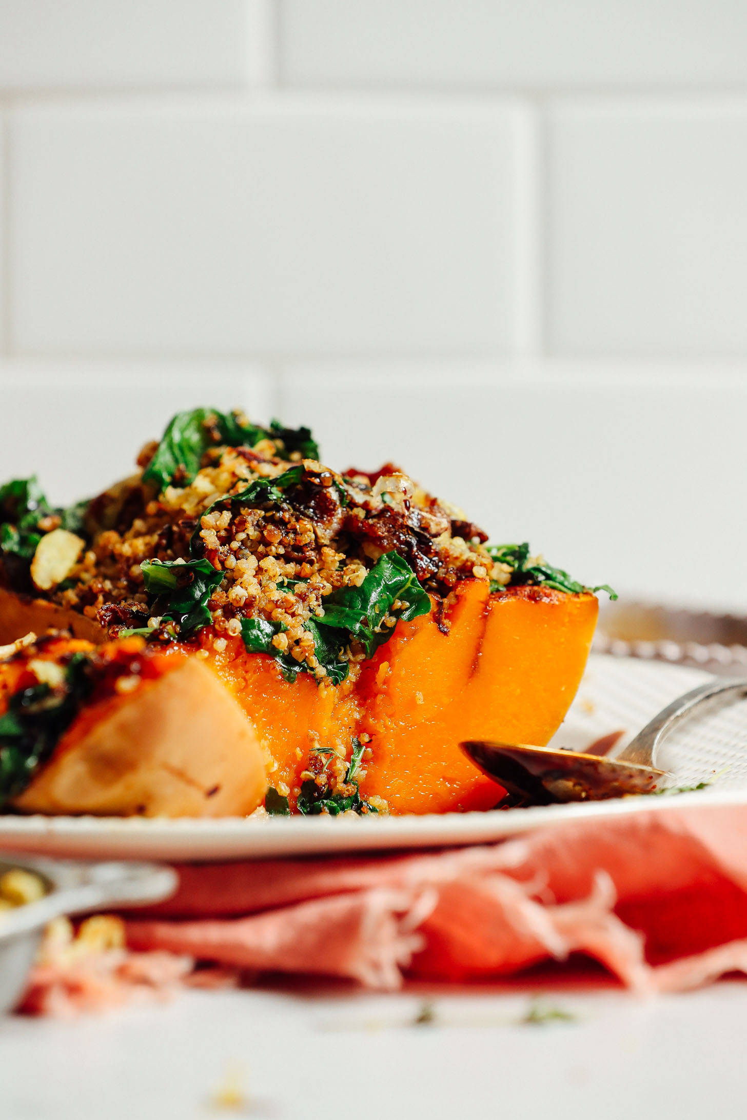 Close up shot of butternut squash stuffed with mushrooms, kale, and quinoa