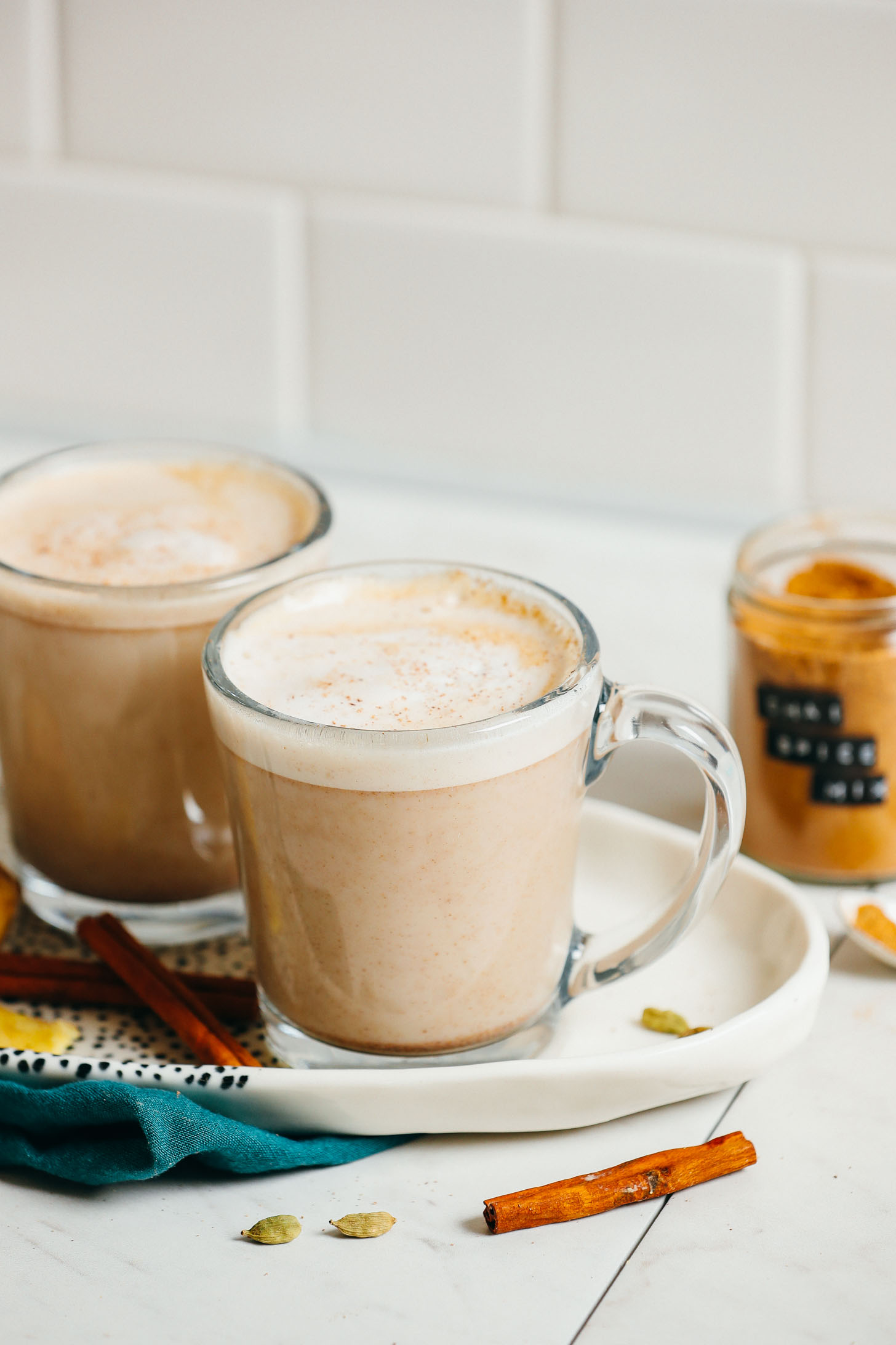 Two vegan chai lattes made with our DIY chai spice mix recipe