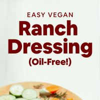 Cutting board with fresh vegetables and bowl of our Easy Vegan Ranch Dressing recipe