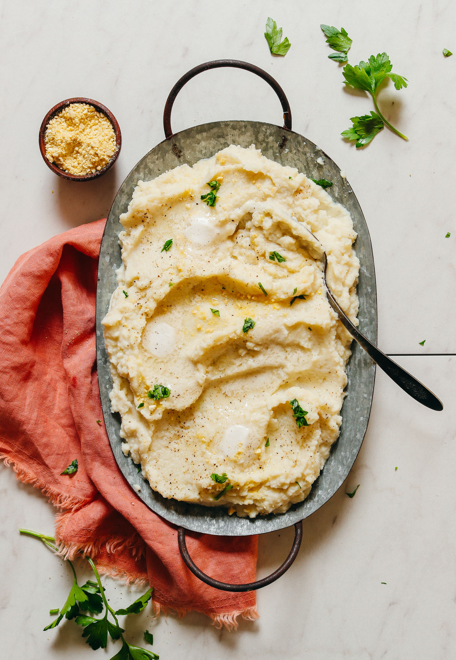 Tray of creamy Garlic Mashed Cauiflower for a vegan Thanksgiving side dish