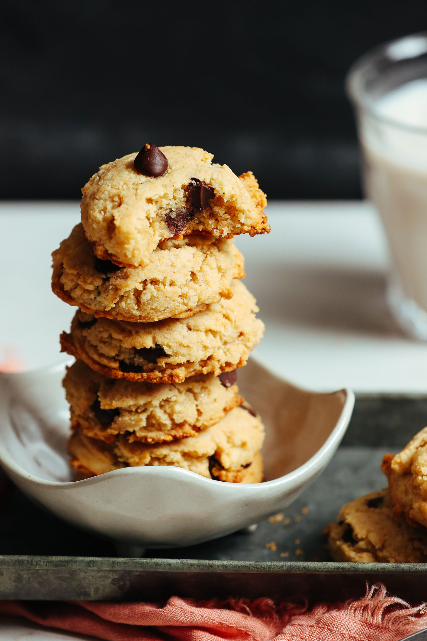 Small bowl with a stack of gluten-free vegan chocolate chip cookies