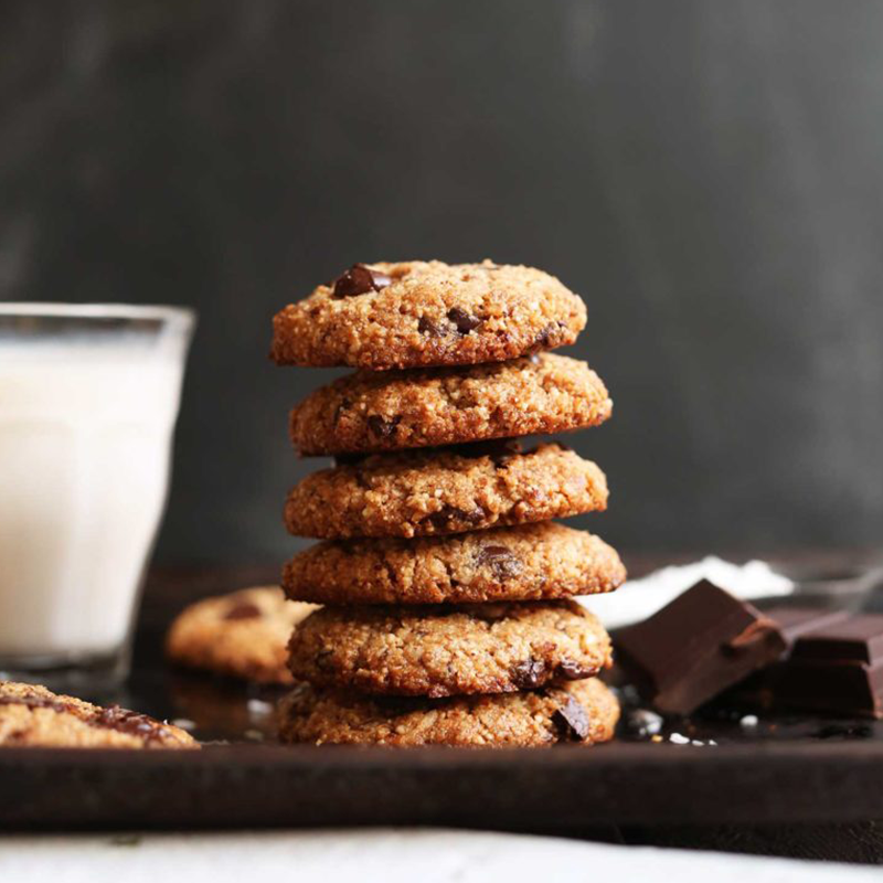 Almond milk and a glass of gluten-free Almond Meal Chocolate Chip Cookies