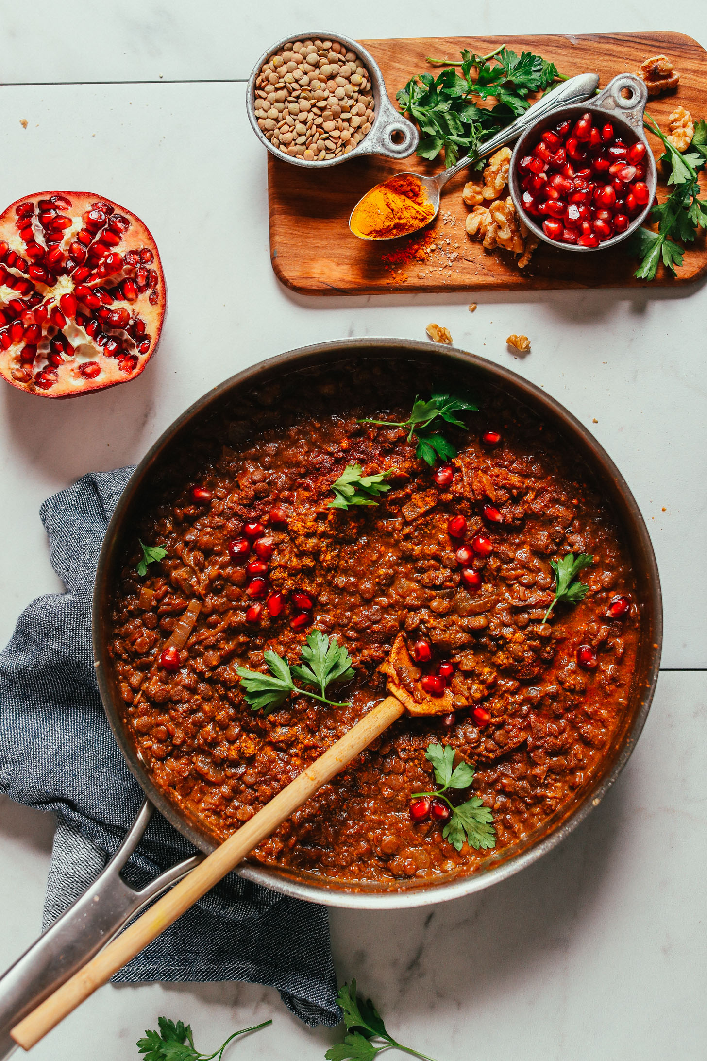 Large skillet filled with a batch of our hearty vegan Lentil Fesenjan recipe