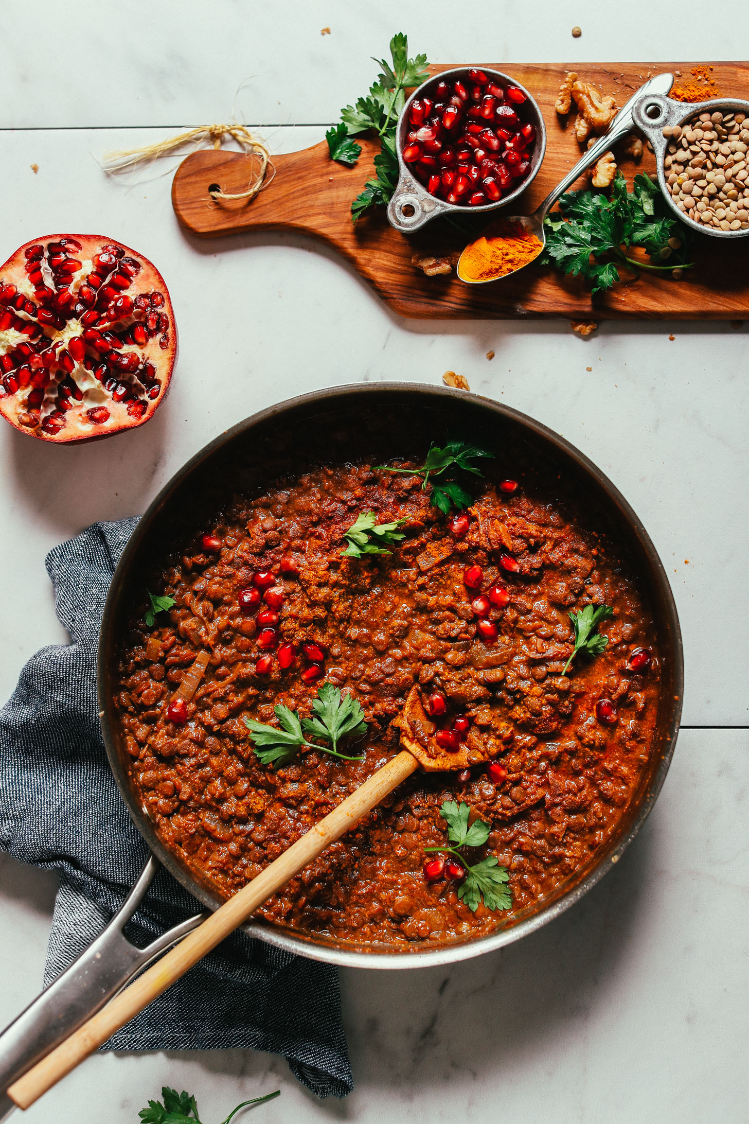 Skillet filled with hearty and flavorful Lentil Fesenjan