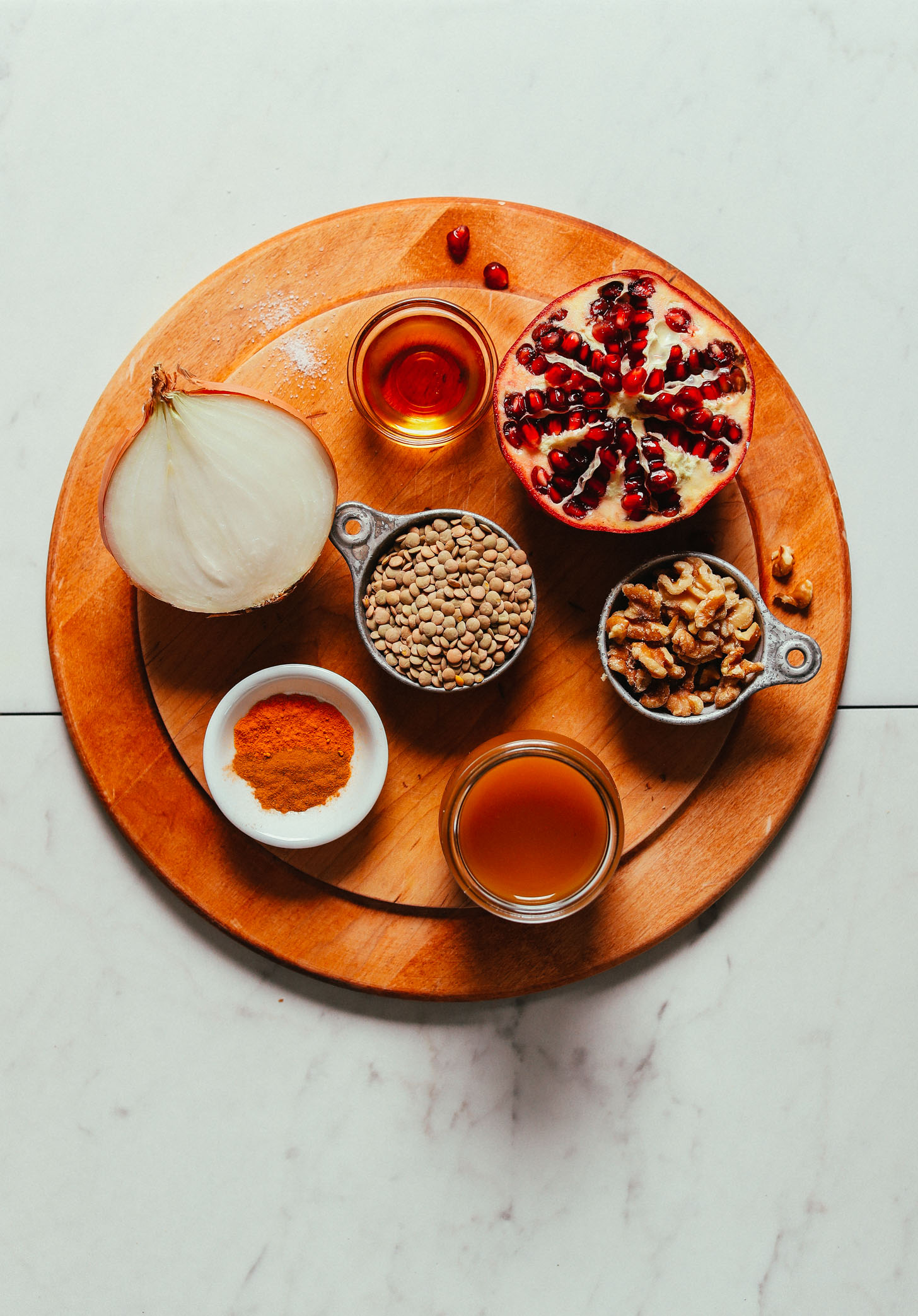 Wood cutting board with ingredients for making satisfying gluten-free vegan Lentil Fesenjan