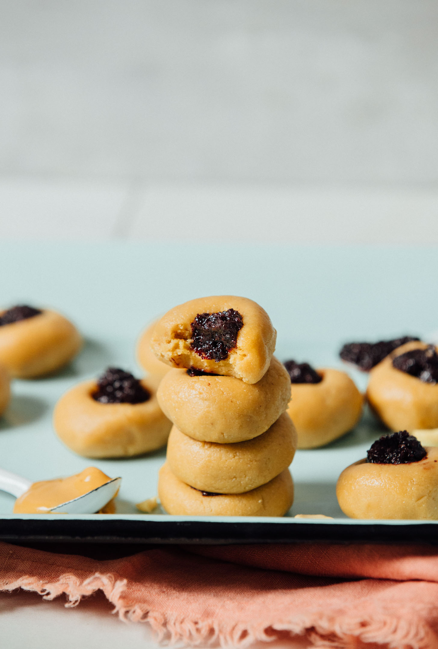 Stack of gluten-free No-Bake Peanut Butter Thumbprint Cookies