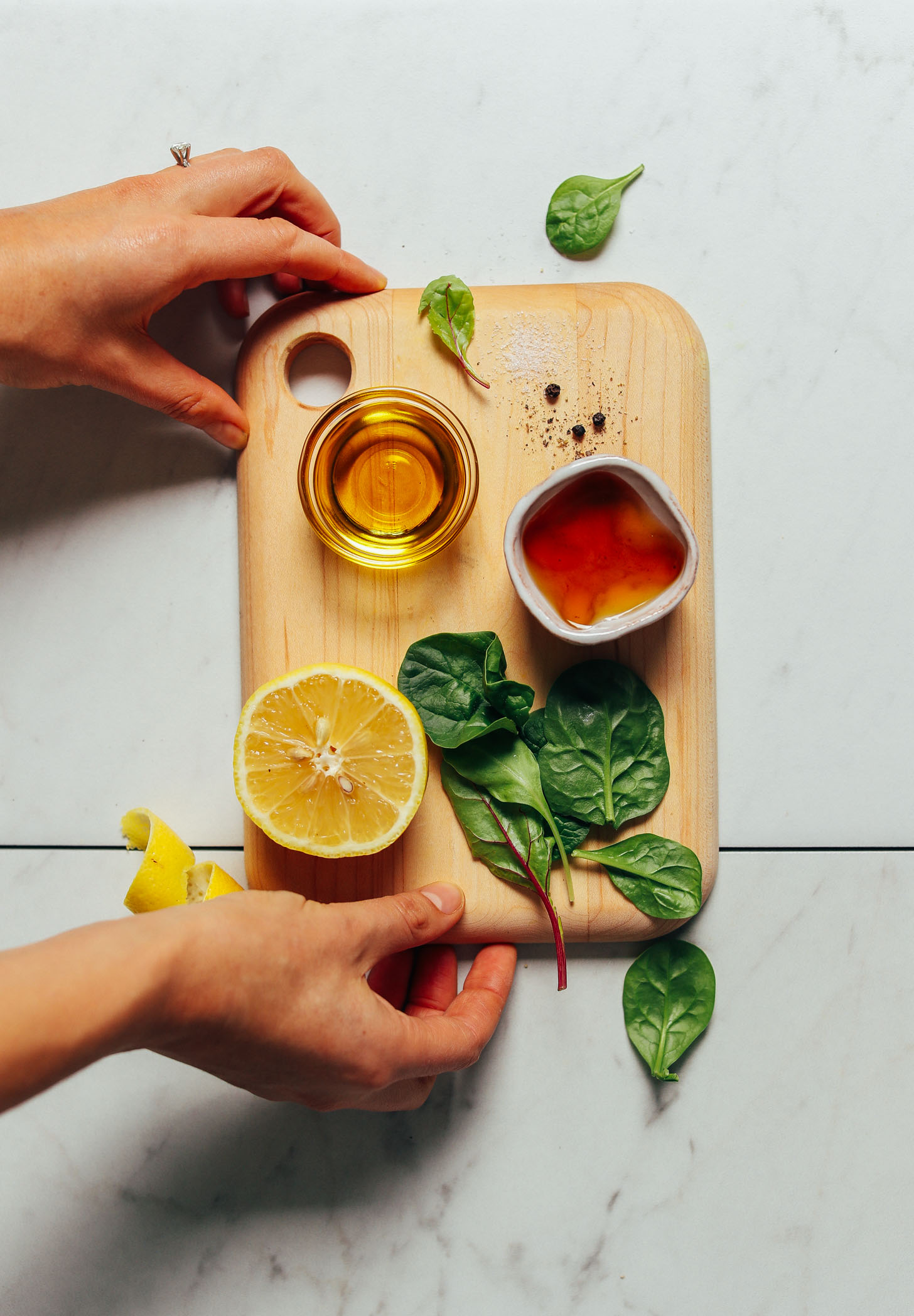 Cutting board with ingredients for making homemade Lemon Vinaigrette