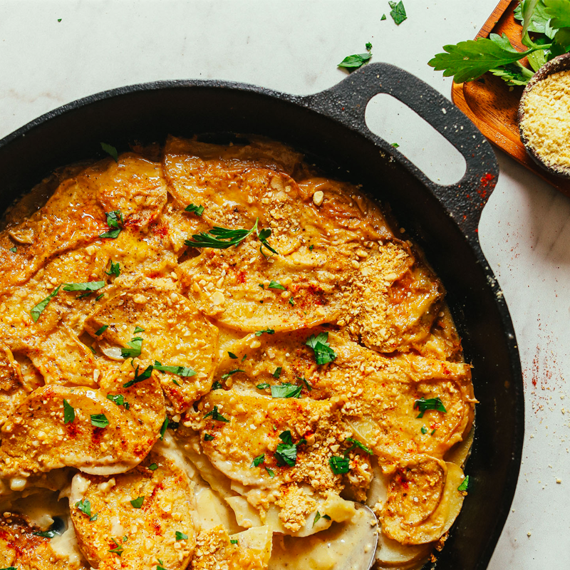 Skillet filled with a batch of our Vegan Scalloped Potatoes