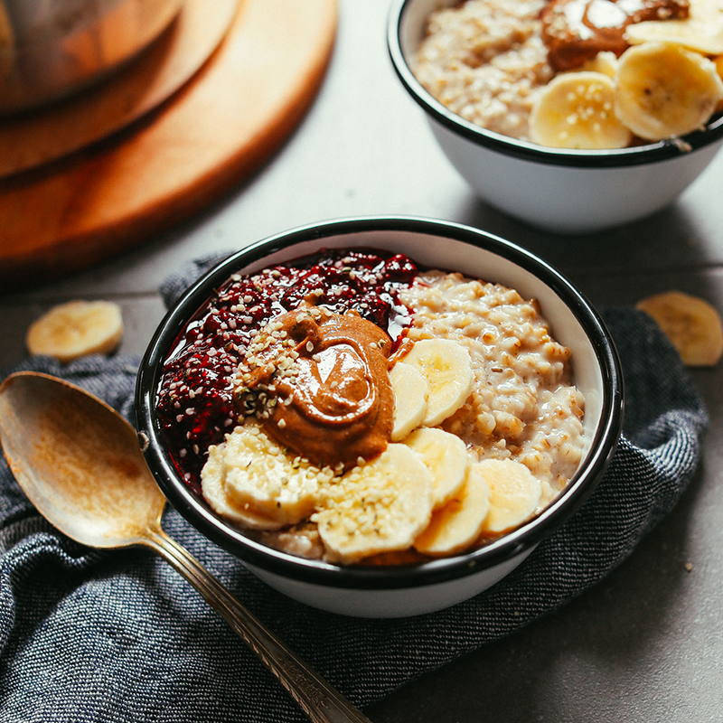 Two bowls filled with oats made using our recipe for fluffy, tender oats