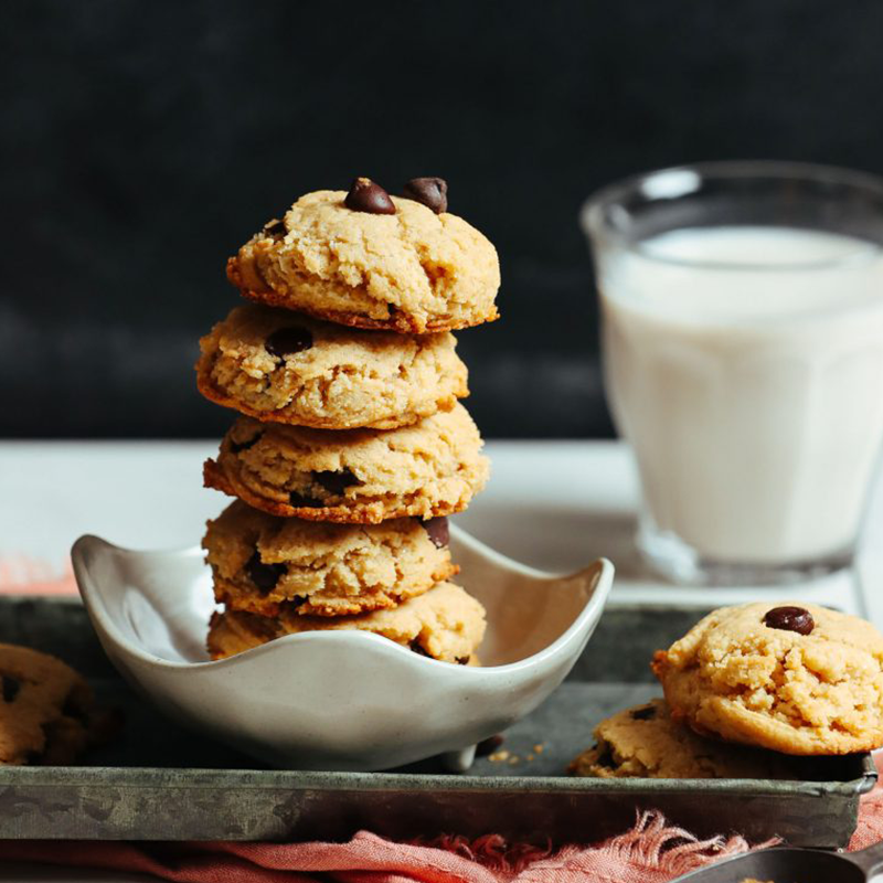 Bowl stacked tall with a batch of our Perfect Vegan Gluten-Free Chocolate Chip Cookies