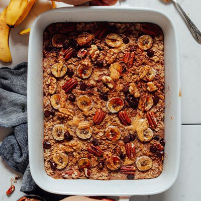 Baking dish of Chocolate Chip Banana Baked Oatmeal made with pecans