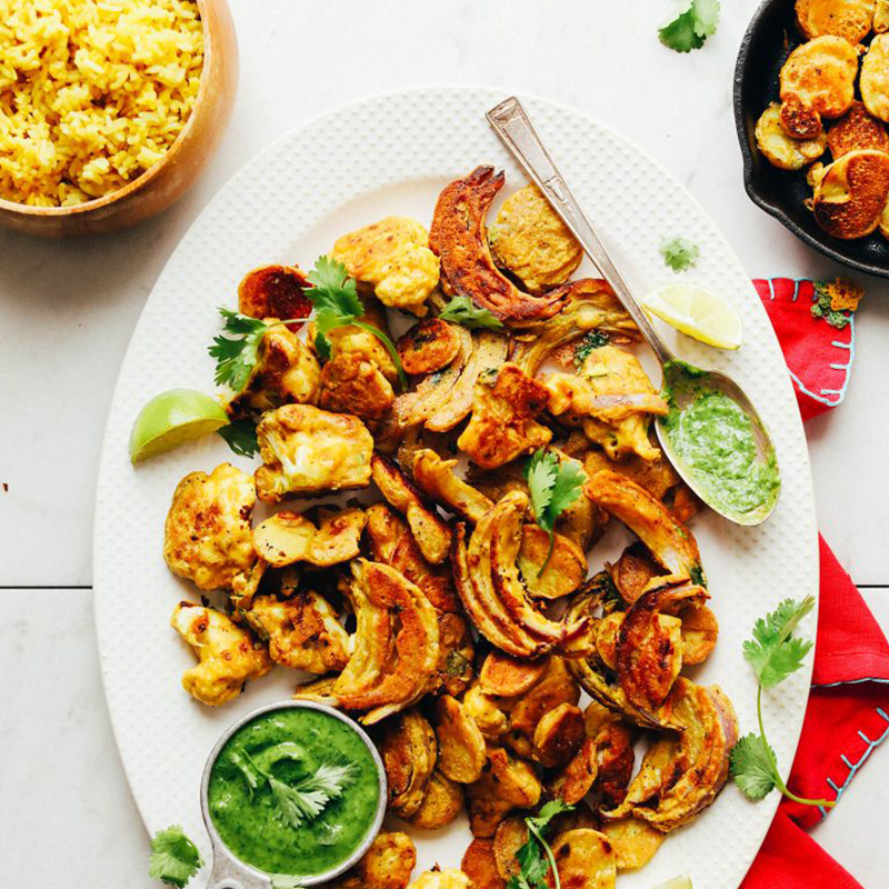 Platter of vegetable pakoras for our roundup of Easy New Year's Snack recipes