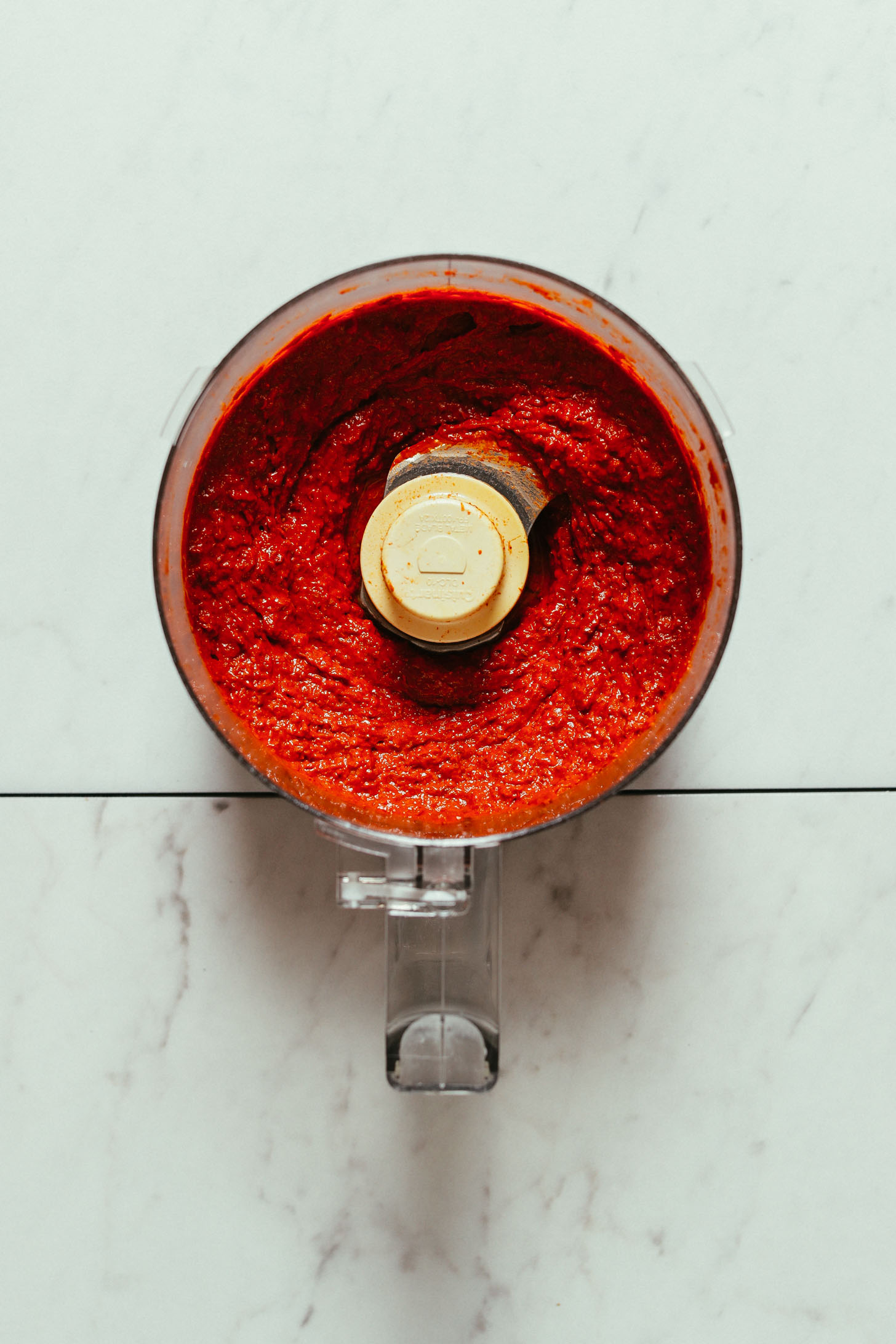 Overhead image of harissa paste blended in a food processor