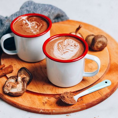 Cutting board with mugs of our homemade Mushroom Latte recipe