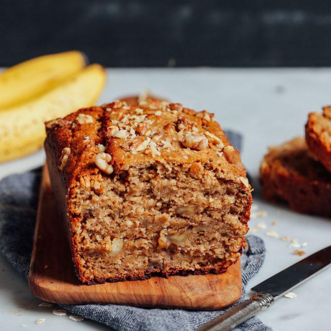Cutting board with a half loaf of Vegan Gluten-Free Banana Bread