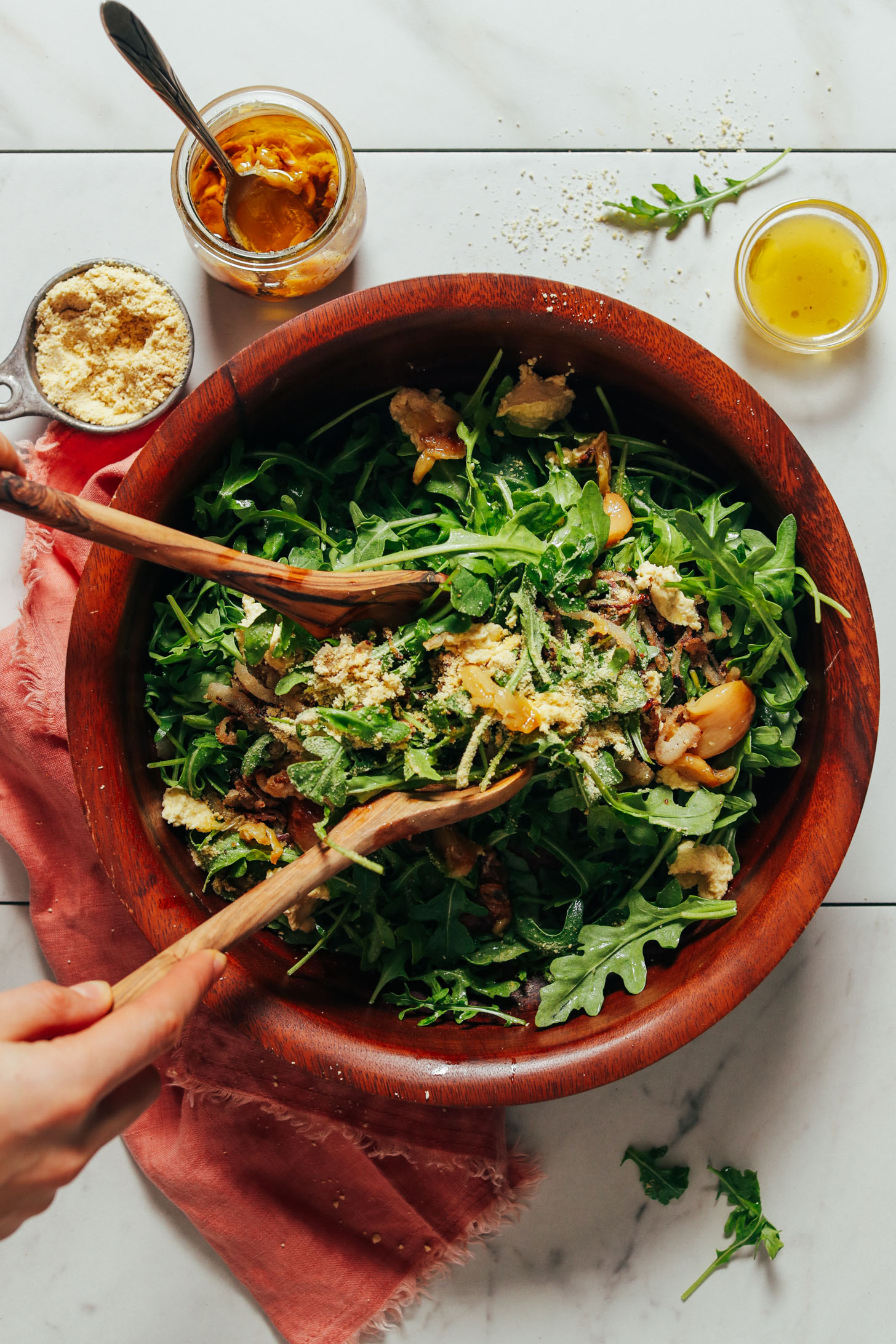 Big bowl of our Lemony Arugula Salad recipe made with crispy shallots and nut cheese