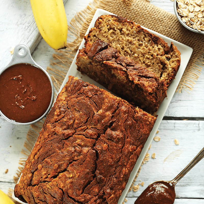 Partially sliced loaf of Nutella Banana Bread for our round-up of Vegan Baked Goods