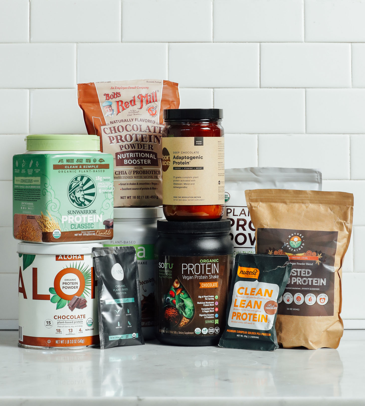 Collection of vegan chocolate protein powders for our unbiased review