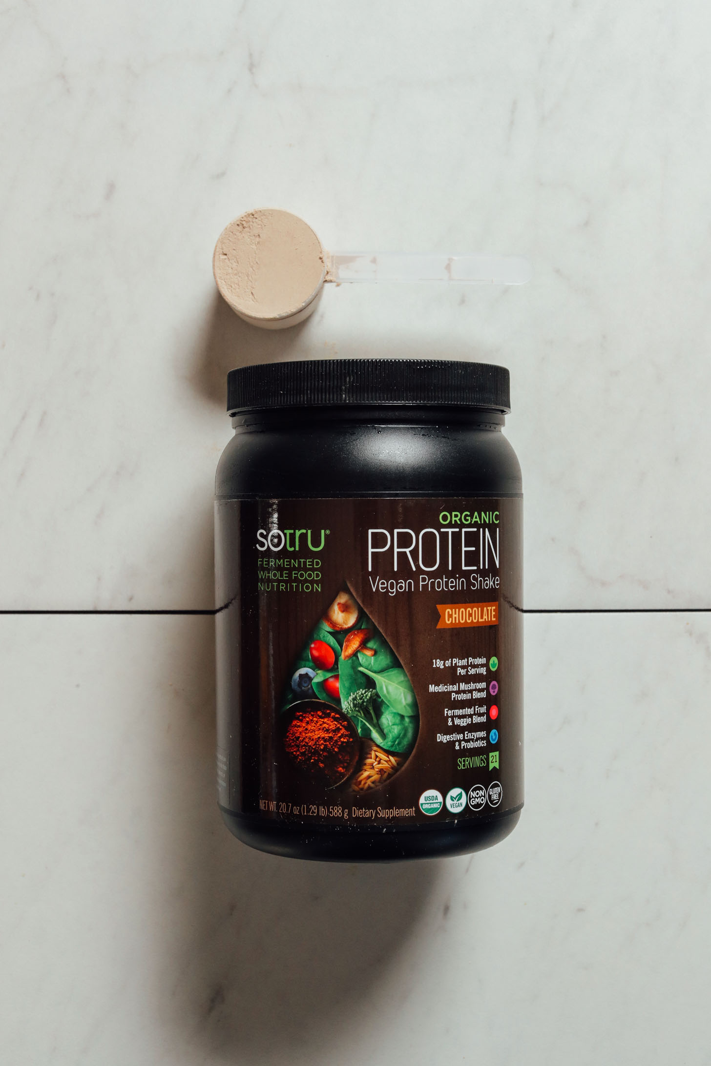 Tub of SoTru Vegan Protein for our chocolate protein powder review